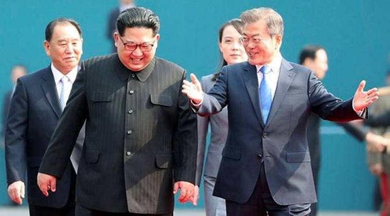 South Korean President Moon Jae-in and North Korean leader Kim Jong Un arrive at the Peace House in the truce village of Panmunjom inside the demilitarized zone separating the two Koreas, South Korea, on Friday. (Reuters)