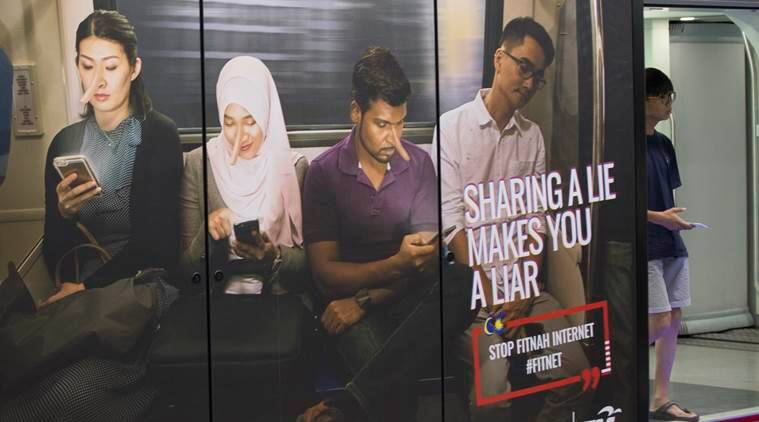 Malaysia approves law banning fake news ahead of elections