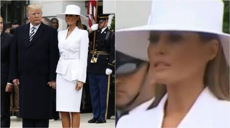 VIDEO: Melania finally holds Donald Trump's hand, but not before putting up a brave fight