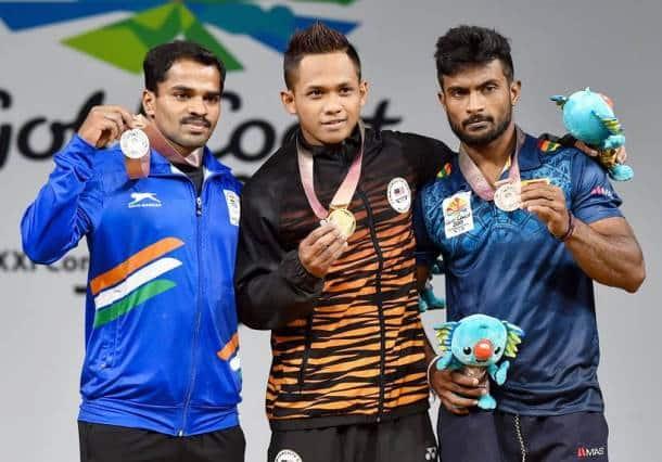 P Gururaja with other medallists at the podium.