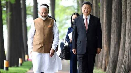 Stroll by lake side, boat ride, discussion over tea: Modi-Xi bonhomie on full display