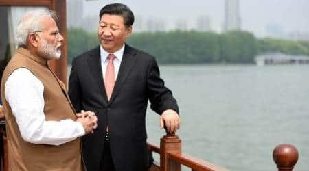 pm modi, modixi jinping meeting, chinesemedia, informal summit,wuhan, modi china visit, indian express