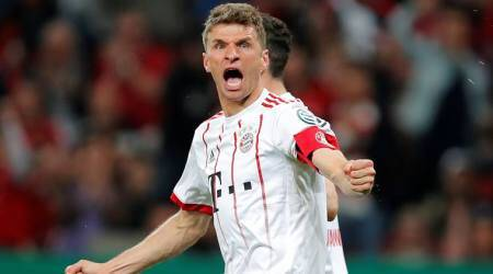 Bayern Munich reach German Cup final after Thomas Mueller hat-trick sinks Leverkusen