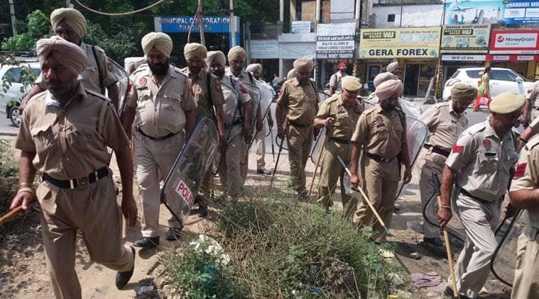 Police personnel patrol Phagwara on Saturday, a day after clashes in Phagwara.