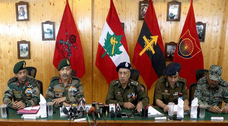 Anil Kumar BhaTt addresses the media along with SP Vaid at the Victor Force Headquarters in Awantipora on Sunday. (Express photo/Shuaib Masoodi)