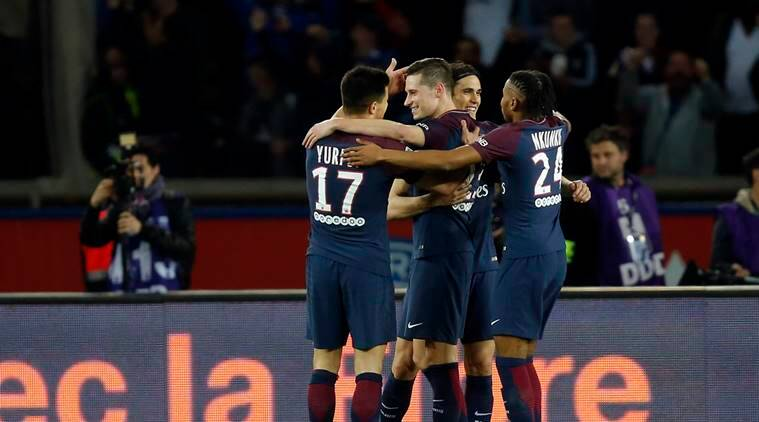 PSG players celebrate after scoring against Monaco