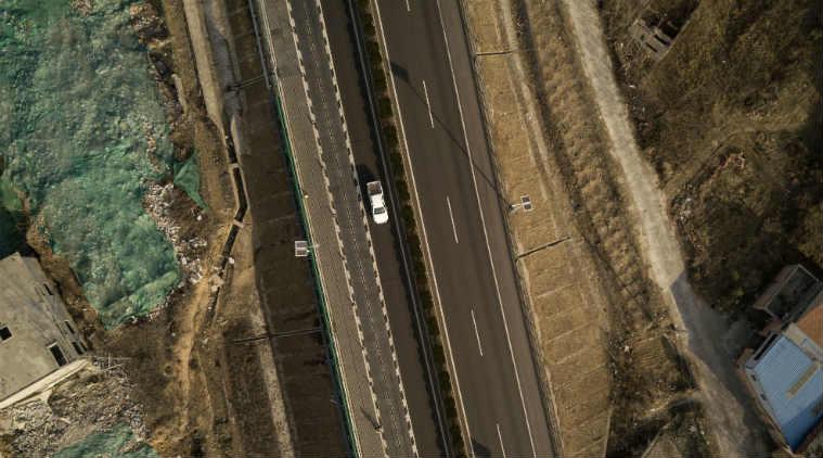 China smart road, electric cars, autonomous technology, Qilu Transportation, car charging systems, transportation business, global EV sales, road infrastructure