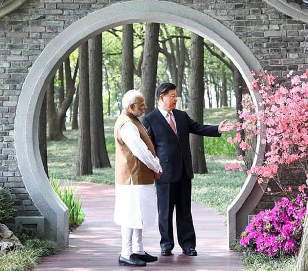 pm modi in china, modi jinping boat ride, modi at east lake, modi jinping pictures, modi jinping meeting, india china summit, india china relations