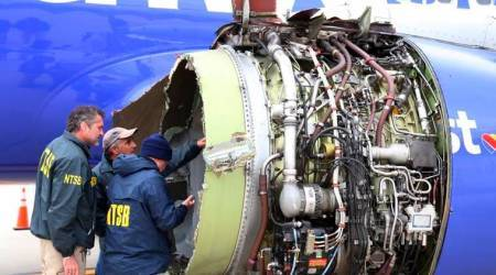 One dead after Southwest jet's engine explodes; woman nearly sucked out
