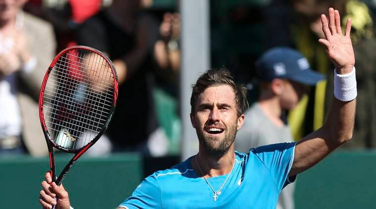 Steve Johnson celebrates after winning the US Men's Clay Court title.