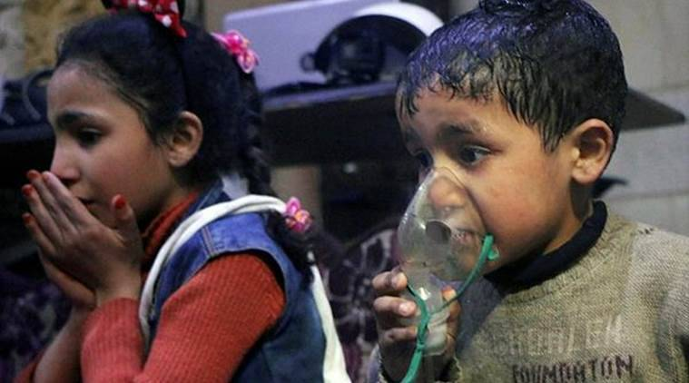 This image released by the Syrian Civil Defense White Helmets, shows a child receiving oxygen through respirators following an alleged poison gas attack in the rebel-held town of Douma. (AP)