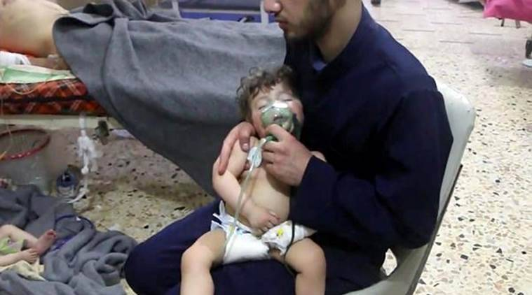 This image made from video released by the Syrian Civil Defense White Helmets, which has been authenticated based on its contents and other AP reporting, shows a medical worker giving toddlers oxygen through respirators following an alleged poison gas attack in the opposition-held town of Douma. (AP)