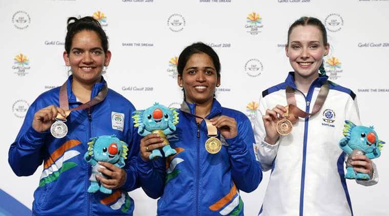 Tejaswini Sawant and Anjum Moudgil on the podium at Commonwealth Games