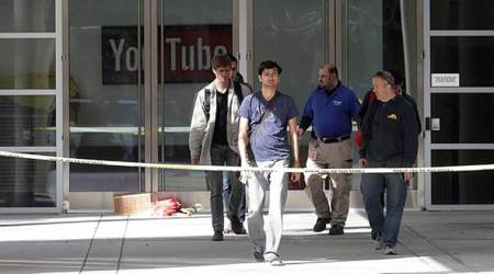 A group walks out of a YouTube office building in San Bruno, California on Wednesday. (AP)