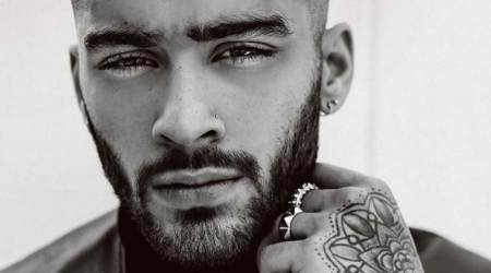 Zayn Malik gets his shaved head tattooed