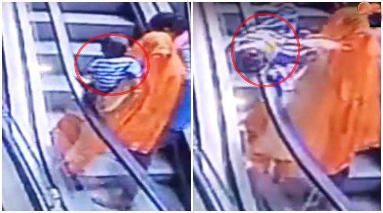 baby slips from mothers hands, baby falls escalator, baby slips escalator gap, baby falls mothers hands, baby fall, baby falls escalator death, baby india escalator fall, indian express, indian express news