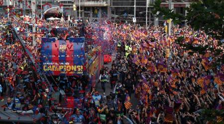 FC Barcelona players and fans celebrate during the parade