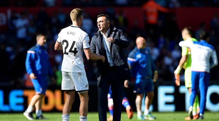 Swansea City manager Carlos Carvalhal with Andy King after the match as they are relegated from the Premier League