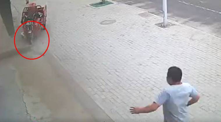 cctv viral video, cctv accident, cctv accident save girl, Chinese man saved a girl, CCTV camera, small girl cctv, indian express, indian express trending news