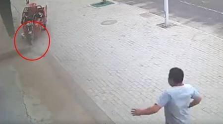 CCTV VIDEO: Heroic man saves girl by throwing himself in front of a vehicle