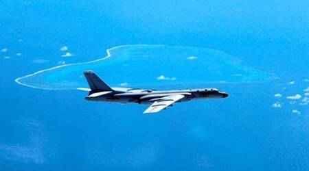 In this undated file photo released by Xinhua News Agency, a Chinese H-6K bomber patrols the islands and reefs in the South China Sea. (AP/File)
