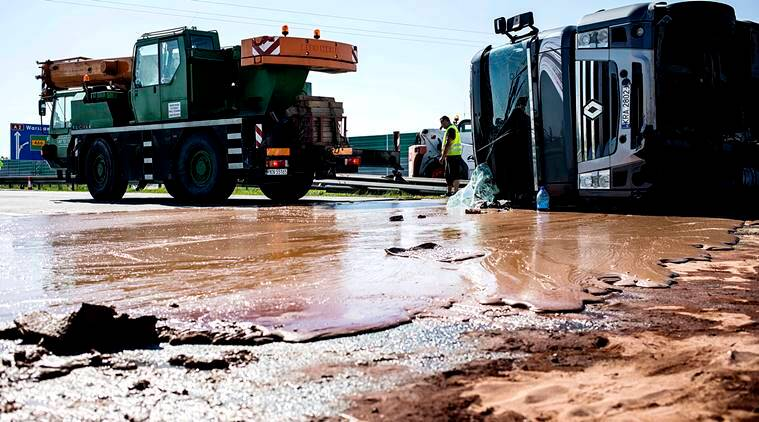 Image result for Tons of liquid chocolate spilled on a six-lane highway after truck overturned