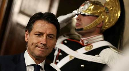 Italy's Prime Minister-designate Giuseppe Conte leaves after a meeting with the Italian President Sergio Mattarella at the Quirinal Palace in Rome on Sunday. (Reuters)