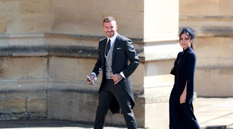 British fashion designer Victoria Beckham and her husband, British former soccer player David Beckham arrive for the royal wedding ceremony of Britain's Prince Harry and Meghan Markle at St George's Chapel in Windsor Castle