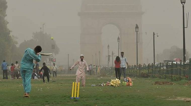 New Delhi: Children play cricket as the weather changes after a dust storm in New Delhi on Wednesday. (PTI)