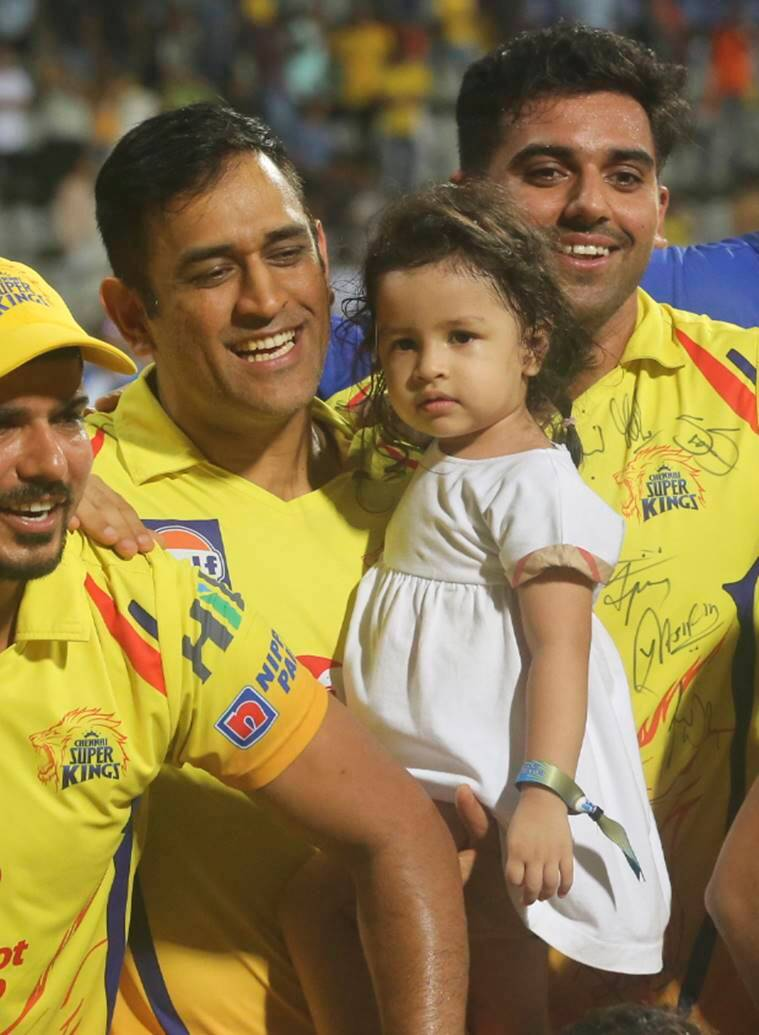 Chennai Super Kings Mahinder Singh Dhoni along with his daughter Ziva celebrates after winning against Sunrisers Hyderabad's at VIVO IPL cricket T20 final match in Mumbai, India