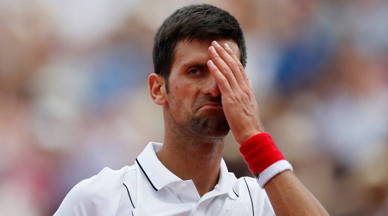 Serbia's Novak Djokovic reacts during his second round match against Spain's Jaume Munar at the French Open