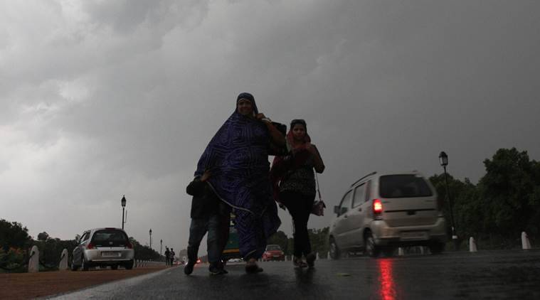 The relief to Delhi residents came after a sweltering day, when the maximum temperature had reached 40.60 degrees Celsius, a notch above the normal, the meteorological department official said. (Express photo/Premnath Pandey)