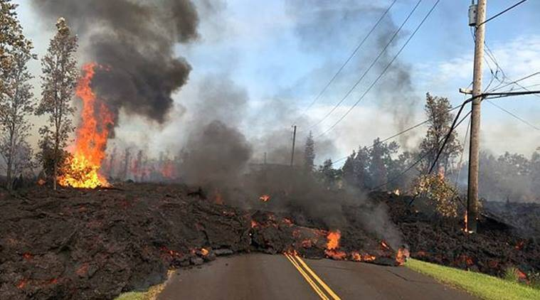 Lava advances along a street near a fissure in Leilani Estates, on Kilauea Volcano's lower East Rift Zone. (Reuters)
