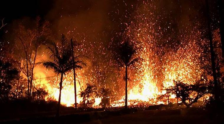 A new fissure spraying lava fountains as high as about 230 feet (70 m), according to United States Geological Survey, is shown from Luana Street in Leilani Estates subdivision on Kilauea Volcano's lower East Rift Zone in Hawaii. (Reuters)