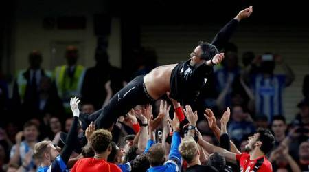 Huddersfield survive relegation after battling draw atChelsea