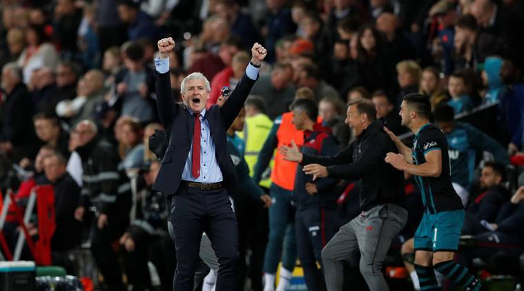 Southampton manager Mark Hughes celebrates after the match against Swansea City