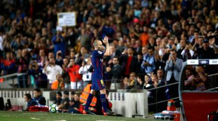 FC Barcelona's Andres Iniesta applauds after being substituted during the Spanish La Liga soccer match between FC Barcelona and Villarreal at the Camp Nou stadium in Barcelona