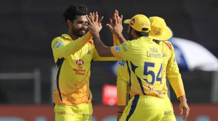 CSK's Ravindra Jadeja celebrates with teammates after picking up a wicket against RCB