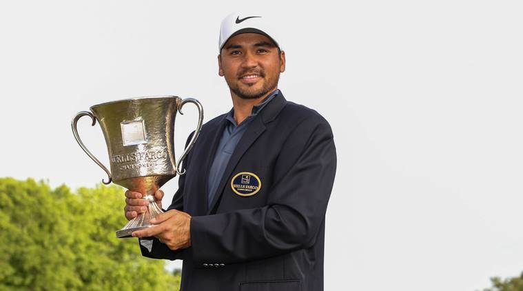 Jason Day with the winning jacket and trophy during the final round of the Wells Fargo Championship golf tournament at Quail Hollow Club
