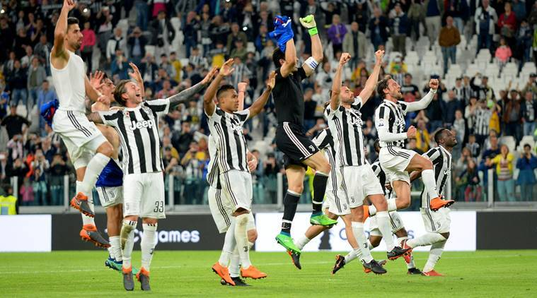 Juventus players celebrate after the match against Bologna