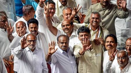 Karnataka Chief Minister H D Kumaraswamy, with other JD(S) and Congress leaders, waves to the media after his coalition government won the trust vote by voice vote, at Vidhana Soudha. (PTI)