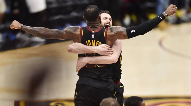Cleveland Cavaliers forward LeBron James (23) and center Kevin Love (0) celebrate after James hit the final shot to win the game against the Toronto Raptors