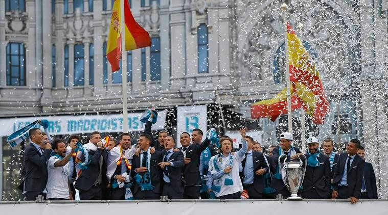 Real Madrid players celebrate with the Champions League trophy in Cibeles square, Madrid, Spain