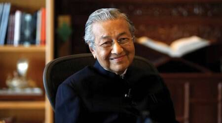 Malaysia PM Mahathir Mohamad says will review MH370 search contract