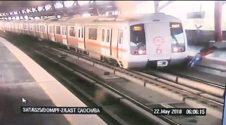 Man hops on Metro track to get  to other side, has a narrow escape