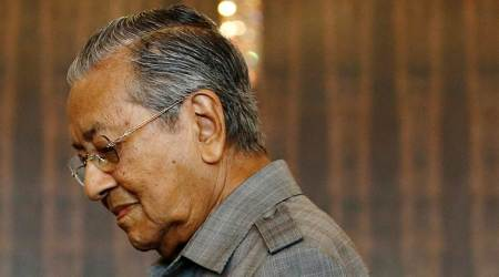 Malaysia's 92-year-old PM says he'll stay in office for 1-2years