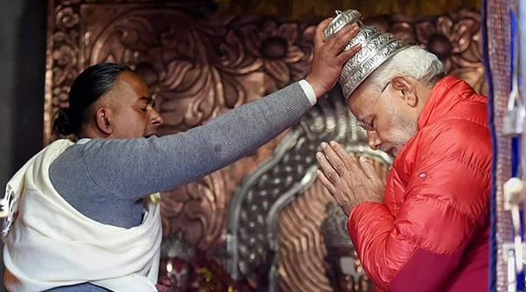 PM Modes offers prayers in Muktinath Temple in Muktinath on Saturday. (PTI)