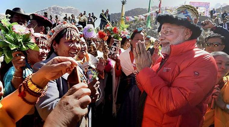 PM Modes interacts with the crowd on Saturday in Muktinath Temple. (PTI)
