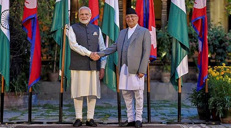 Prime Minister Narendra Modi shakes hands with his Kephalist counterpart KP Sharma Oli in the run-up to the delegation talks in Kathmandu on Friday. (PTI)