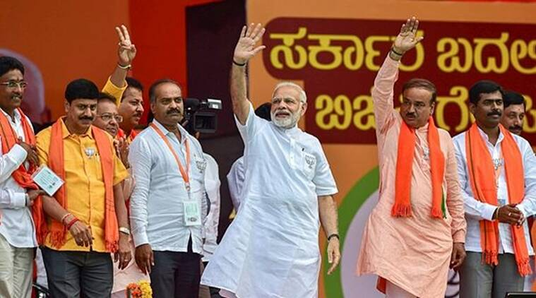 Prime Minister Narendra Modi waves along with Ananth Kumar and other BJP leaders during a public rally in Bengaluru on Thursday. (File)